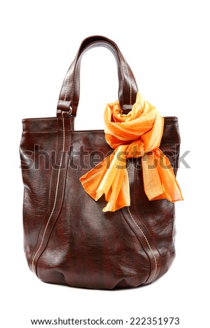 Modern fashionable female bag and scarf with tassels isolated on white background. - stock photo