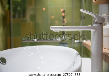 Modern faucet and wash basin in luxury bathroom  - stock photo