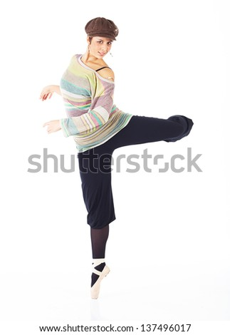 Modern female ballet dancer with black pants and a colorful striped jersey and cap en pointe on a white background in various ballet positions. - stock photo