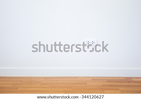 Modern female plug in white wall background. - stock photo