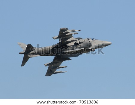 Modern fighter jet performing vertical takeoff - stock photo