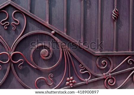Modern forged decorative gates - stock photo