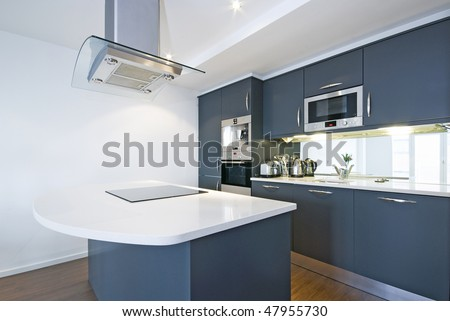 Modern fully fitted kitchen with kitchen appliances - stock photo