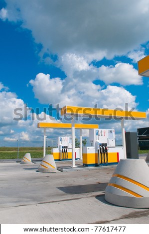 modern gas station with a background sky - stock photo