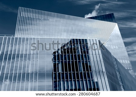 modern geometric abstraction glass windows of a skyscraper - stock photo