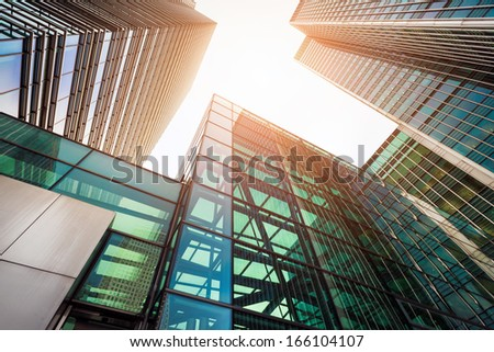 Modern glass exterior of corporate office buildings shot from a low angle. - stock photo
