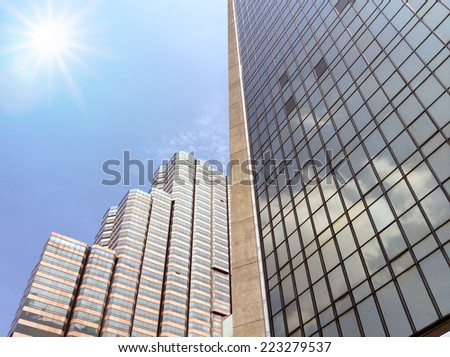 Modern glass silhouettes of skyscrapers with sun, Business building  - stock photo