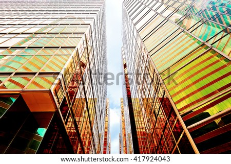 Modern glass skyscrapers perspective in the city - stock photo