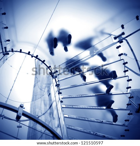 modern glass spiral staircase in shop with motion step - stock photo