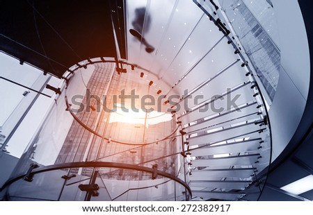 Modern Glass Staircase Silhouette of walking People - stock photo