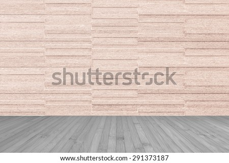 Modern granite tile wall pattern textured background in light red brown color with wooden floor in grey color tone : Horizontal stone tile wall pattern texture with wood flooring   - stock photo