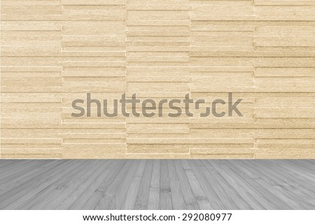 Modern granite tile wall pattern textured background in light yellow cream beige color with wooden floor in dark grey color tone : Horizontal stone tile wall pattern texture with wood flooring        - stock photo