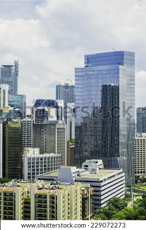 Modern green buildings in Makati City, Manila, Philippines - stock photo