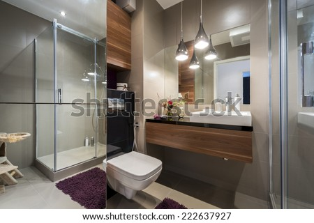 Modern grey and beige bathroom with shower  - stock photo