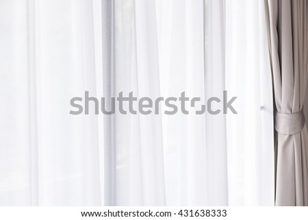 Modern grey and white curtains in living room - stock photo