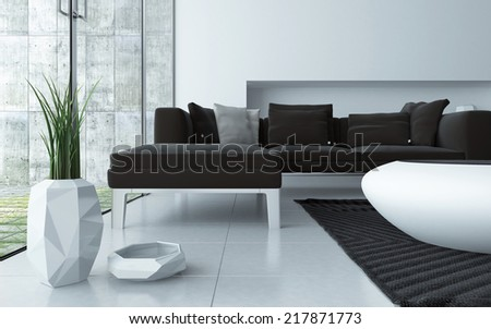 Modern grey and white living room interior viewed low angle over a tiled floor with an upholstered lounge suite , stylish contemporary coffee table and ornamental pot plant in front of large windows - stock photo