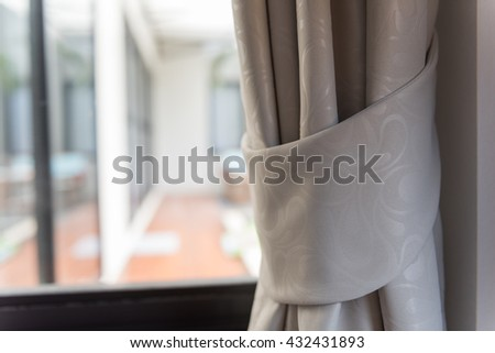 Modern grey curtains in livinng room - stock photo