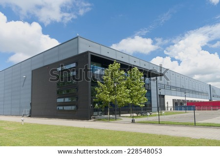 modern grey warehouse in the Rotterdam harbor area - stock photo