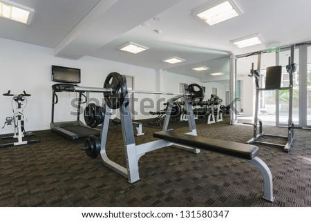 Modern gym interior with equipment - stock photo