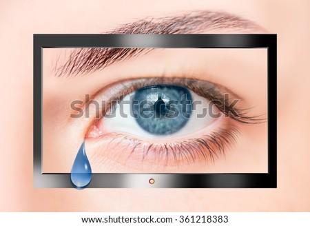 Modern HD TV showing a beautiful female gray eye.  - stock photo