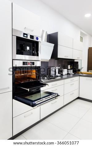 Modern hi-tek kitchen, oven with door open - stock photo