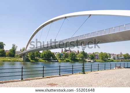 Modern High bridge over the river Meuse in Maastricht, The Netherlands - stock photo