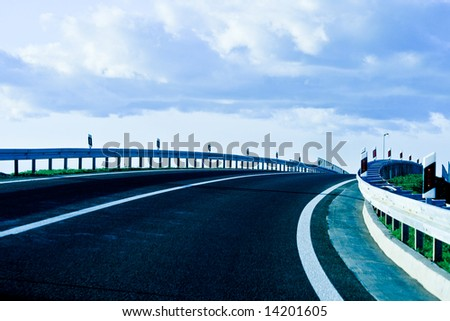 Modern highway and clouds - stock photo