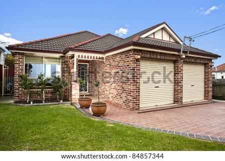 modern home against a blue sky - stock photo