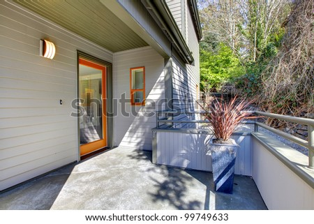 Modern home entrance with brown walls and woods. - stock photo