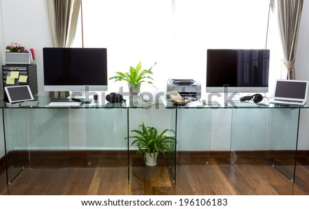 Modern home office with computer and laptop - stock photo