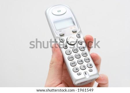 modern home phone in hand - stock photo