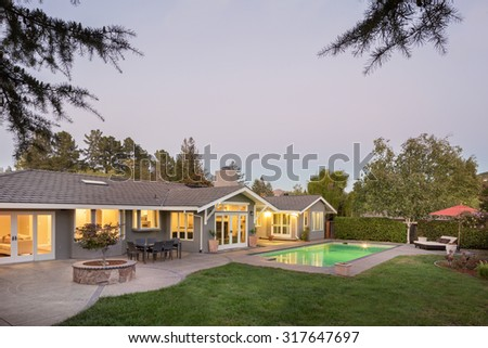Modern home with swimming pool - stock photo