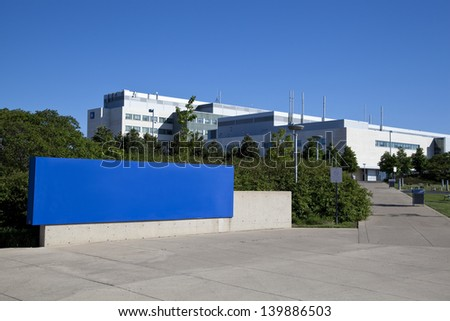 Modern hospital and sign with clear blue sky - stock photo