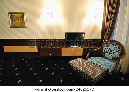 modern hotel room appartment indoor with double bed and lcd tv - stock photo
