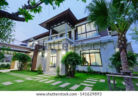 Modern house at night - stock photo