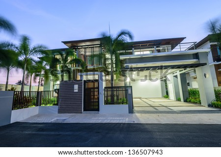 Modern house at night on windy day - stock photo