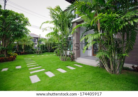 Modern house in the garden  - stock photo