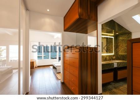 Modern house interior, corridor overlooking bathroom, nobody inside - stock photo