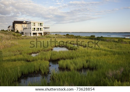 Modern house located at the famous West Hamptons area along Dune road. Long Island , New York - stock photo