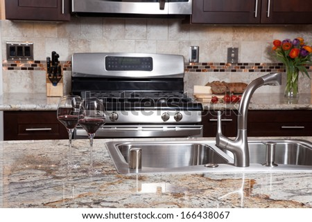 Granite countertop stock photos images pictures for Marvellous modern luxury kitchen with granite countertop