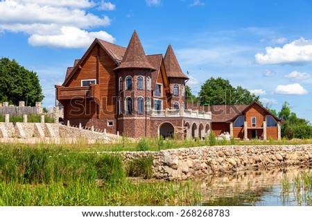 Modern house on the lake in summer sunny day in Novgorod region, Russia - stock photo
