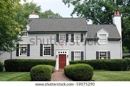 Modern House with Red Door - stock photo