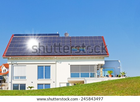 Modern house with solar cells in nature - stock photo