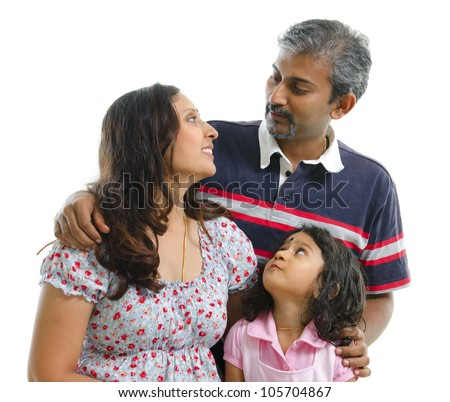 Modern Indian family having conversation on white background - stock photo