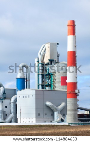 modern industrial building with a high chimney. Outside view. - stock photo