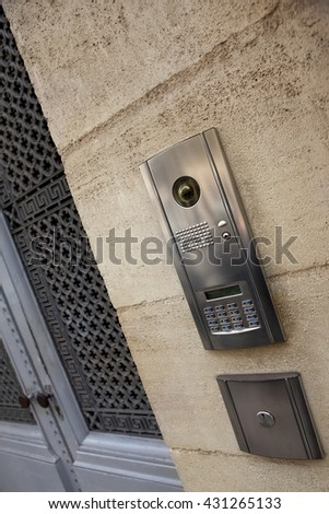 Modern intercom on a stoned facade of a French mansion - stock photo