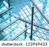 Modern interior abstract fragment with steel railings and stairs made of glass - stock photo