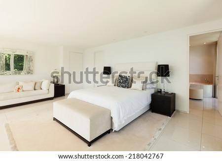 Modern interior design, comfortable bedroom - stock photo
