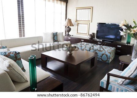 modern interior design living room with white sofa and brown center table - stock photo