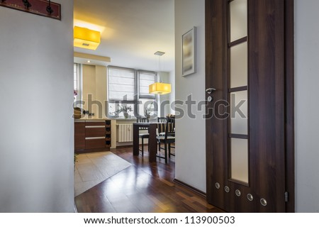 Modern interior design with wide view to dinning room - stock photo
